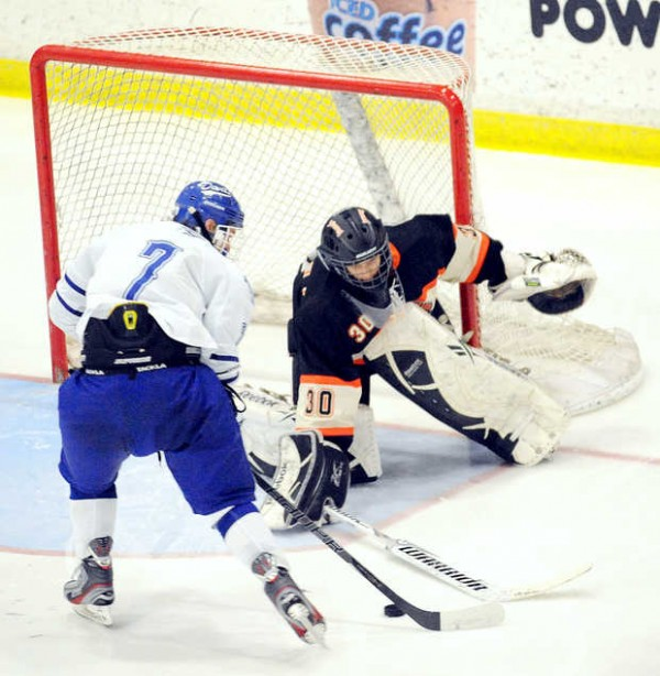 Brunswick's Blake Alexander is able to stop a shot on goal by Cameron Marquis during their Eastern Class A semifinal game in Lewiston on Saturday. Alexander left the game in the second period after Lewiston's sixth goal.