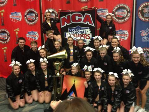 The Planet Cheer Galaxy cheering team of Lewiston displays the trophy and jackets it earned by winning its division at the National Cheerleaders Association All-Star Nationals in Dallas, Texas, on March 2-3, 2013.