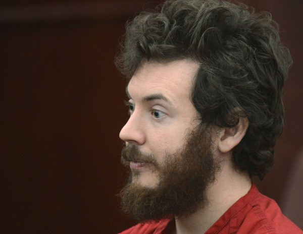 Accused Aurora theater gunman James Holmes listens during his arraignment in Centennial, Colorado March 12, 2013. A Colorado judge presiding over the case of Holmes entered a not guilty plea on his behalf on Tuesday to charges that he went on a shooting spree nearly eight months ago that killed 12 moviegoers.