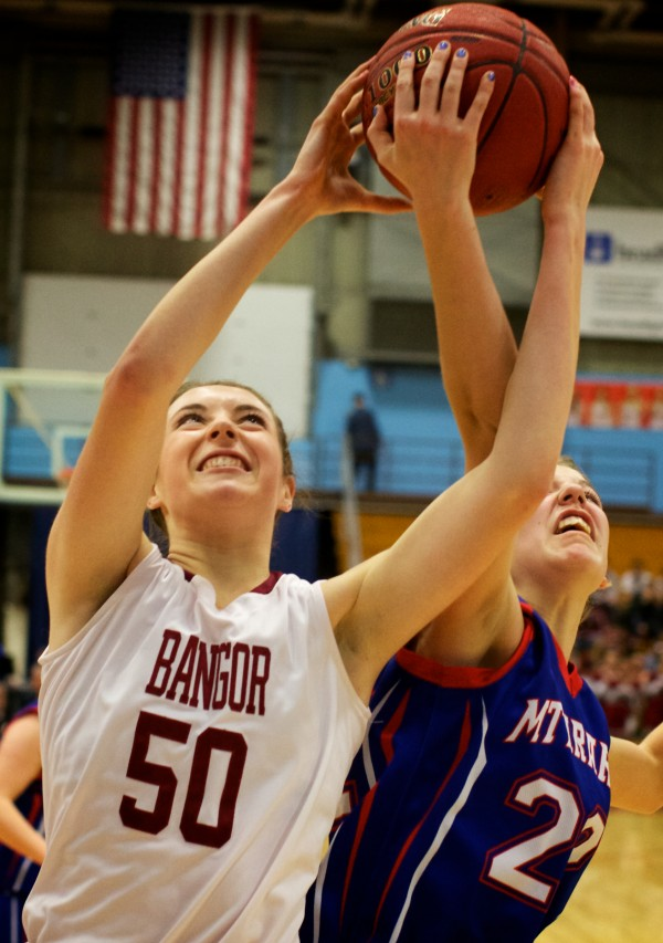 Bangor's Cordelia Stewart (left) fights for a rebound against Mount Ararat's Olivia Swan during an Eastern Maine Class A semifinal last week in Augusta. Stewart will lead Bangor when it plays for the state title against McAuley at 4 p.m. Saturday in Augusta.