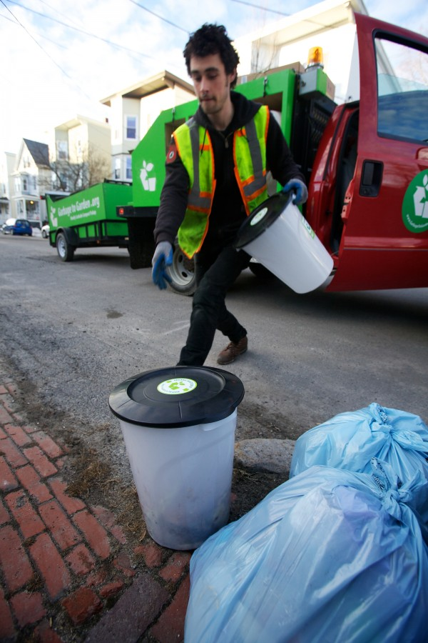 Lee Michael of Garbage to Garden exchanges a bucket of food scraps for a clean bucket in the Munjoy Hill neighborhood in Portland on Wednesday morning. Garbage to Garden offers curbside composting to its customers.