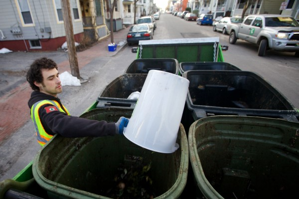 Lee Michael of Garbage to Garden empties a bucket of food scraps in the Munjoy Hill neighborhood of Portland on Wednesday morning. Garbage to Garden offers curbside composting to its customers.