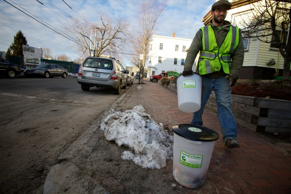 Cory Fletcher of Garbage to Garden exchanges a bucket of food scraps for a clean bucket in the Munjoy Hill neighborhood of Portland on Wednesday morning. Garbage to Garden offers curbside composting to its customers.