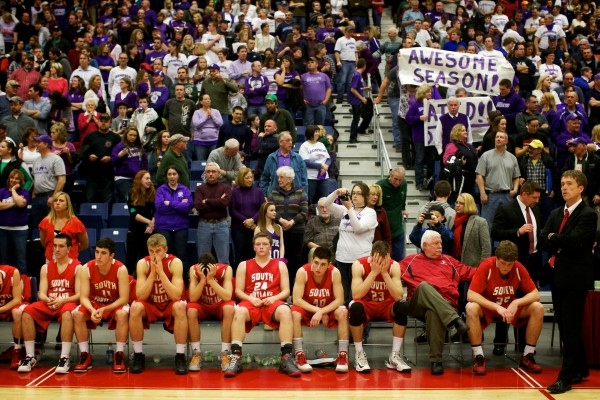 The South Portland High School basketball team sits on its bench after losing to Hampden Academy 45-41 at the Maine State Class A Basketball Championship game Saturday in Augusta.
