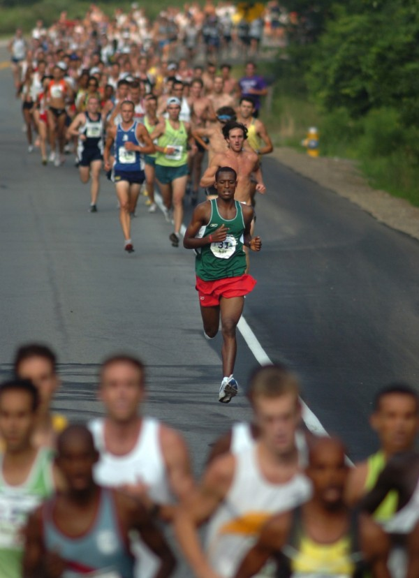 Ayalew Taye, 19 -year-old from Cape Elizabeth (center) distances himself from the pack of Maine runners early in 2007's Beach to Beacon 10K in Cape Elizabeth, while the elite runners (foreground) separate themselves from the rest of the field.