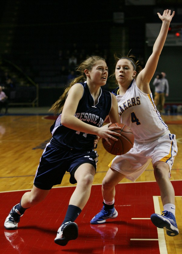 Presque Isle Wildcats' Chandler Guerrette (left) drives for the basket as Lakers Sydney Hancock guards her during the first half of Class B basketball state championship Friday, March 1, 2013, at the Cumberland County Civic Center in Portland.