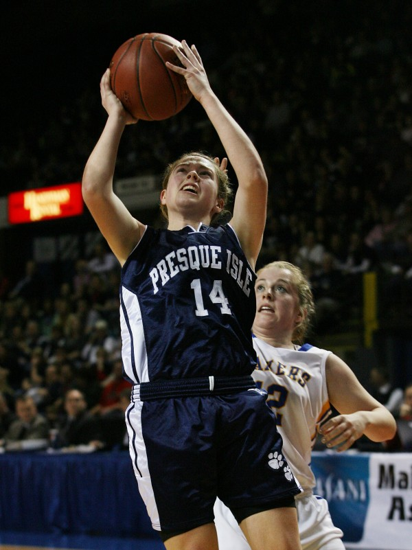Presque Isle Wildcats' Chandler Guerrette shoots as Lakers' Sarah Hancock guards her during the first half of Class B basketball state championship Friday, March 1, 2013, at the Cumberland County Civic Center in Portland.