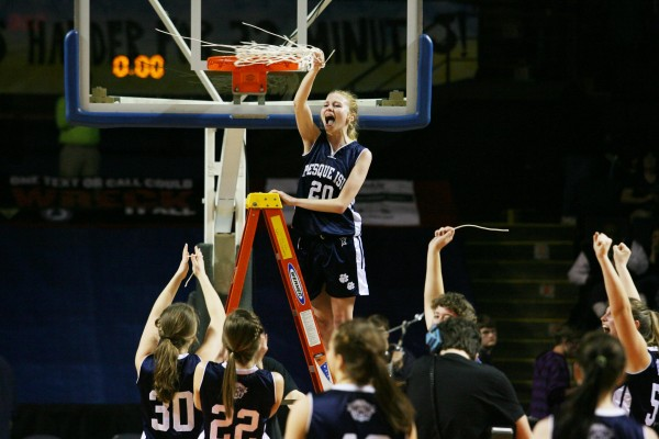Presque Isle Wildcat Karlee Bernier (center) and her teammates celebrate after winning the Class B basketball state championship Friday, March 1, 2013, at the Cumberland County Civic Center in Portland. The Wildcats beat the Lakers 51 to 44.