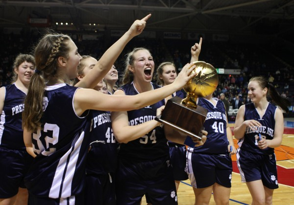 The Presque Isle Wildcats celebrate after winning the Class B basketball state championship Friday, March 1, 2013, at the Cumberland County Civic Center in Portland. The Wildcats beat the Lakers 51 to 44.