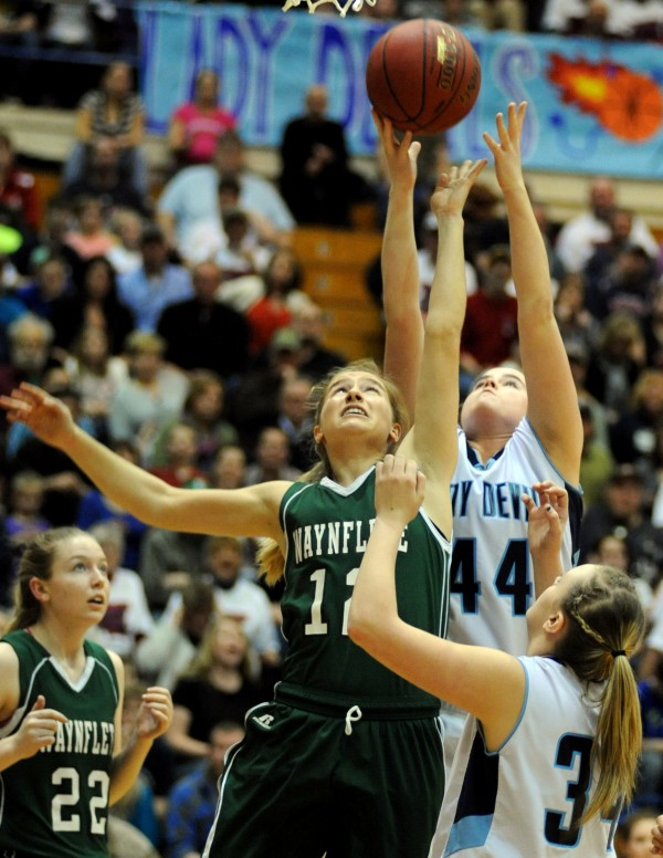 Wayneflete's Martha Veroneau and Paige Gillespie go up for a rebound in first half action of the Class C girls state championship game at the Bangor Auditorium Saturday night.