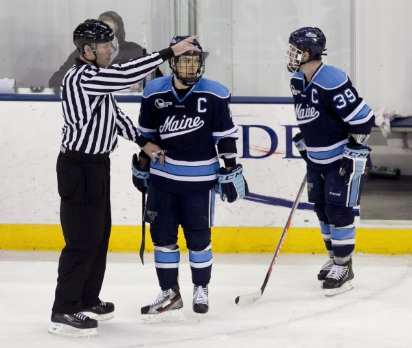 Maine's Joey Diamond (right)is ejected in the second period against UMass Lowell, Friday, March 15, 2013, in Lowell, Mass., during the second game of their Hockey East quarterfinal series.