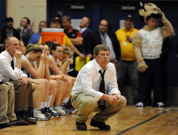 Calais coach Dana Redding and the team watch the last minute of the girls Class C  state championship game against Waynflete at the Bangor Auditorium Saturday night.  Waynflete won the game 59-55.