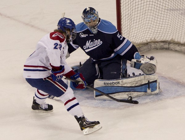 Maine goalie Martin Ouellette robs UMass Lowell's Scott Wilson on a breakaway while shorthanded in the first period, Friday, March 15, 2013, in Lowell, Mass., during the second game of their Hockey East quarterfinal series.