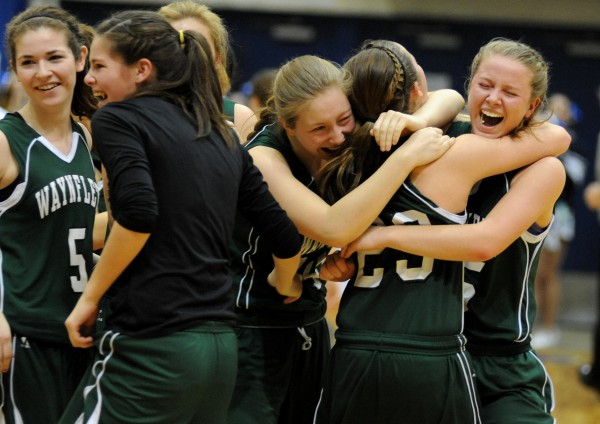 The Waynflete Flyers celebrate their 59-55 victory over Calais in the Class C girls state championship game at the Bangor Auditorium Saturday night.