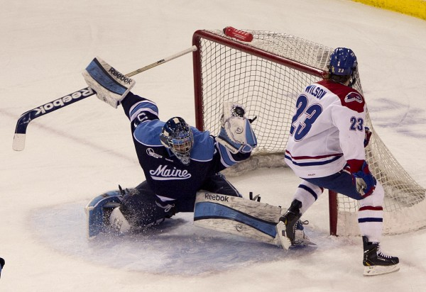 Maine goalie Martin Ouellette robs UMass Lowell's Scott Wilson on a breakaway while shorthanded on the first period, Friday, March 15, 2013, in Lowell, Mass., during the second game of their Hockey East quarterfinal series.