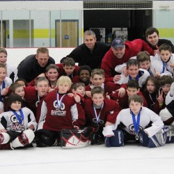 Members and coaches of the Bangor Youth Hockey Tier IV peewee youth hockey teams, White and Red, pose together after the White Peewees defeated the Red Peewees to win the March Showdown Tier IV hockey tournament on Sunday, March 3. The annual tournament hosted by Maine Hockey Development included teams from Massachusetts and Rhode Island.