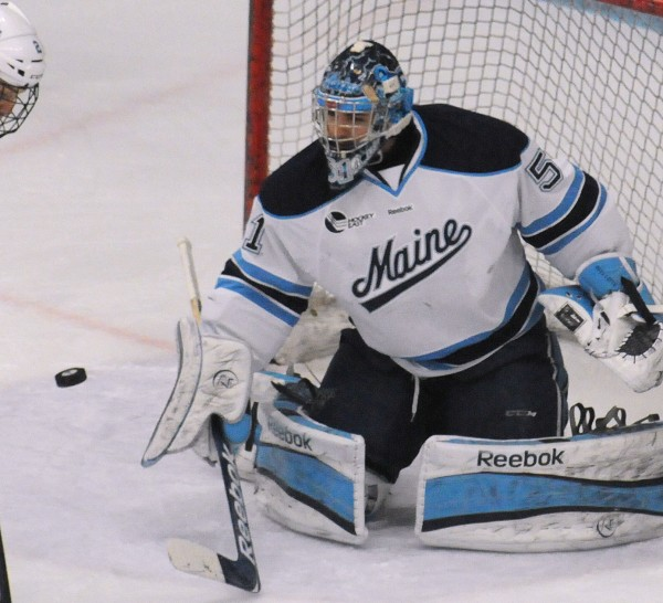 The University of Maine's Martin Ouellette makes a save during the first period of the Friday evening game against Northeastern in Orono.