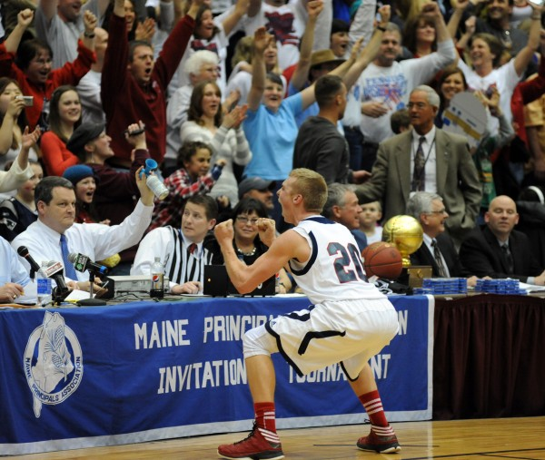 Penquis Valley's Trevor Lyford celebrates with the crowd after defeating Boothbay to clinch the Class C boys state championship Saturday night.  Penquis won the game 61-54 in the final tournament game held at the Bangor Auditorium.