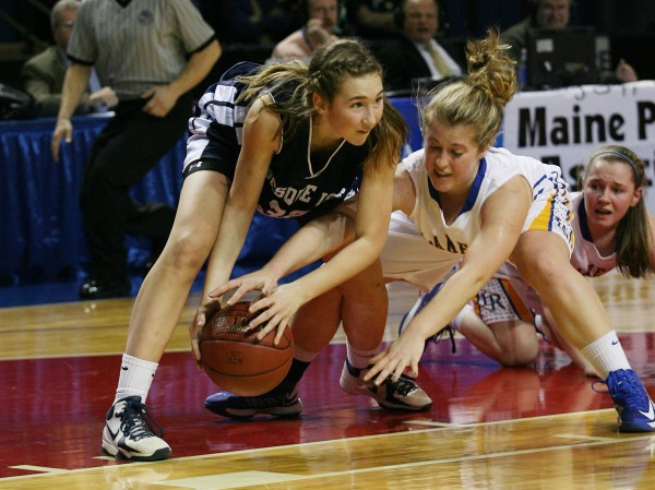 Presque Isle Wildcat Hannah Graham battles the Lakers' Savannah Devoe for a loose ball during the second half of the Class B basketball state championship Friday, March 1, 2013, at the Cumberland County Civic Center in Portland.