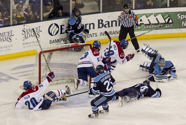 UMass Lowell's Derek Arnold scores the winning goal in overtime against Maine, Friday, March 15, 2013, in Lowell, Mass., during the second game of their Hockey East quarterfinal series.