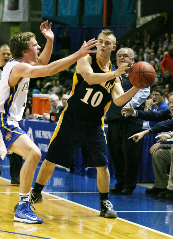 Medomak Panther's Boone Olsen is guarded by Falmouth's Thomas Wilberg during the Class B basketball state championship Friday, March 1, 2013, at the Cumberland County Civic Center in Portland.