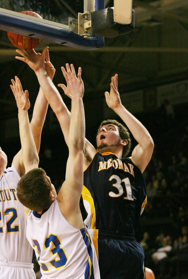 Medomak Panther's Ryan Ripley goes for a rebound during the Class B basketball state championship Friday, March 1, 2013, at the Cumberland County Civic Center in Portland.