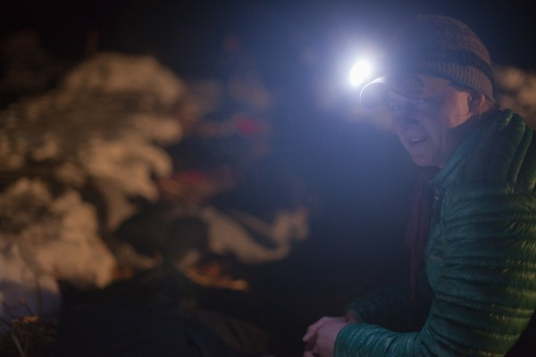 Laura Daugereau of Port Gamble, Wash., puts her team to sleep at the Allagash checkpoint on Sunday, March 3, 2013.