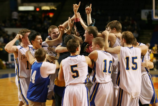 Falmouth High School celebrates winning the Class B basketball state championship Friday, March 1, 2013, at the Cumberland County Civic Center in Portland. Falmouth beat Medomak 62 to 39.