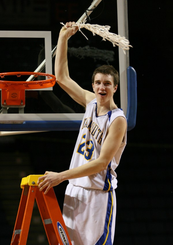 Falmouth High School's Charles Fay swing the net in celebration after winning the Class B basketball state championship Friday, March 1, 2013, at the Cumberland County Civic Center in Portland. Falmouth beat Medomak 62 to 39.