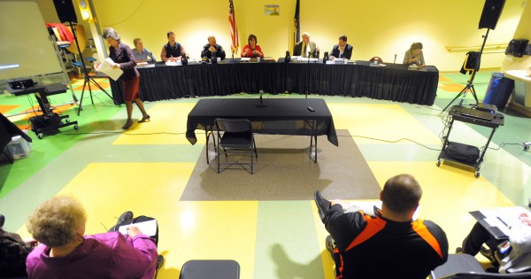 The Brewer School Board gets ready for their meeting at the Brewer Community School on Monday evening.