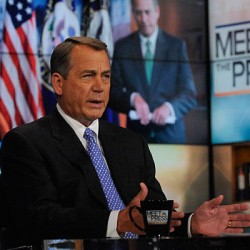 Obama says spending deal close, while Boehner doesn't agree