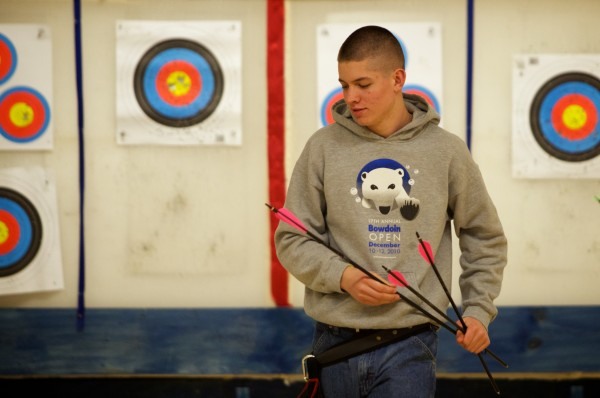 Hayden Eilinger, 15, retrieves his arrows at Nicely Equipped Archery in Gorham. Eilinger says he shoots about 120 arrows a day, seven days a week.