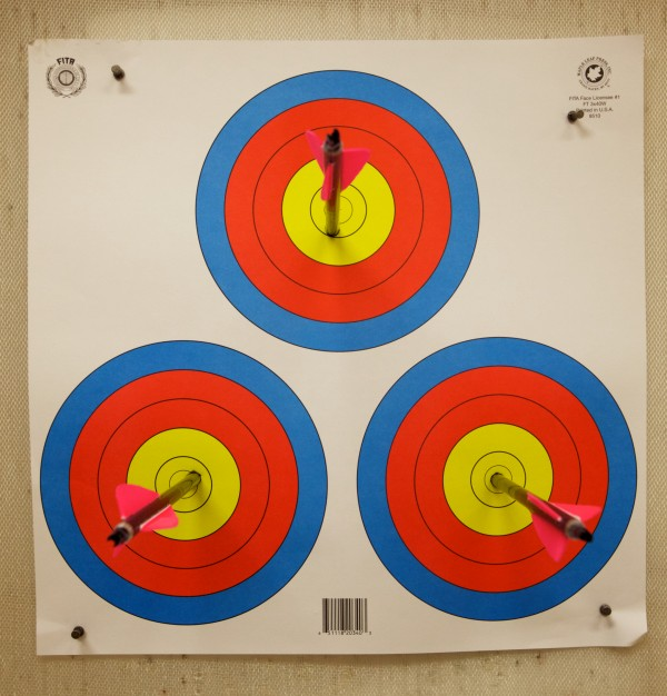 Three arrows find their mark at Nicely Equipped Archery in Gorham on an open shoot night.