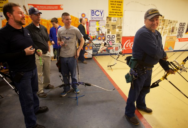 Maine Archery Association Vice President Bill Duncanson (left) offers good-natured ribbing to President Matt Nicely in Gorham on an open shoot night. The association's indoor state championships will be held this weekend at Central Maine Archery in Auburn.