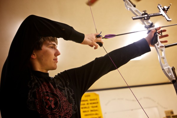 Forrest Lizotte, 18, draws his bow on an open shoot night at Nicely Equipped Archery in Gorham. Lizotte will compete this weekend at the Maine Archery Association's indoor state championships at Central Maine Archery in Auburn.