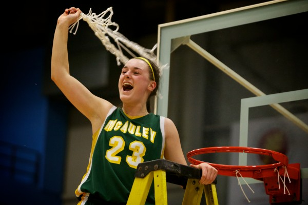Catherine McAuley High School co-captain Alexandra Clement celebrates her team's victory Saturday in the Maine Class A Championship game at the Augusta Civic Center.