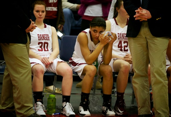 Bangor High School basketball players (from left) Elizabeth Dana, Denae Johnson and Mary Butler sit on the bench after their loss Saturday in the Maine Class A Championship game at the Augusta Civic Center.