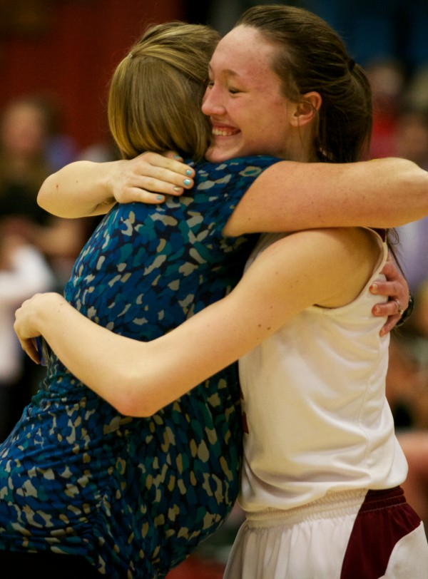 Bangor High School head coach Katie Herbine hugs forward Mary Butler Saturday at the end of the Maine Class A Championship game at the Augusta Civic Center.