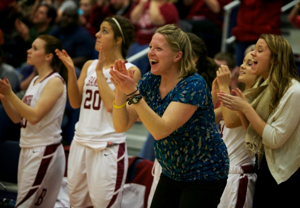 Bangor High School girl's basketball coach Katie Herbine cheers on her team Saturday in the Maine Class A Championship game at the Augusta Civic Center.