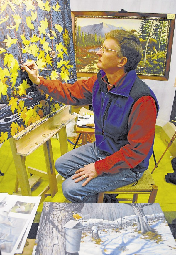 While an exhibitor at the 75th Annual Eastern Maine Sportsmen's Show, artist Mark McCollough works on a painting depicting sugar maple leaves turning bright yellow alongside the Allagash River.
