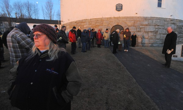 Barbara Wilbur (left) turns around to look at the sunrise at the end of the church service held at the Thomas Hill Standpipe Easter Sunday morning.
