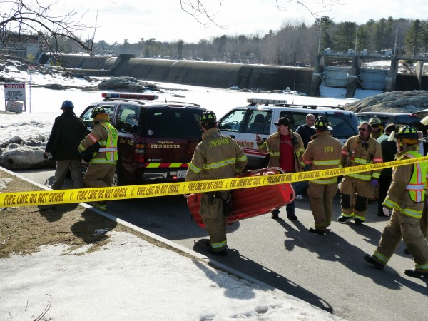 Topsham Fire and Rescue workers head down towards the rocks below the Frank J. Wood or &quotGreen&quot Bridge to retrieve the body of a man police say apparently jumped from the bridge earlier today. He was spotted by a passerby who called 911. Police were dispatched to the scene at 2:41 p.m.