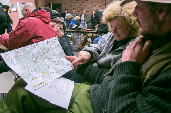 Gino Roussel (right) of New Brunswick and Ruth Sands (left) of Delaware examine the race route for the Can-Am Crown 250-mile sled dog race, which started Saturday in Fort Kent. Roussel said this was his first year competing in the Can-Am and, although he is excited, his &quotstomach is full of butterflies.&quot