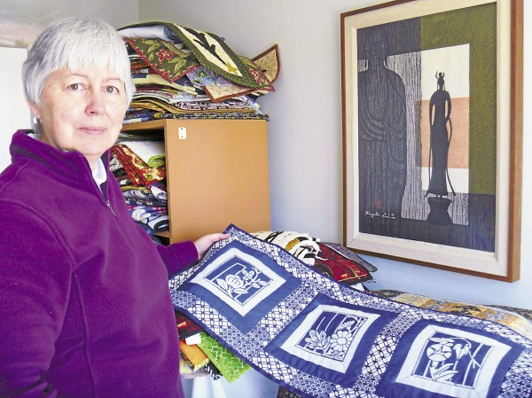 Carole Halteman of Orono, owner of Colorfest Quilting, has stacks of quilted wallhangings and lap-size quilts ready for display at various shows and venues in Maine this year.