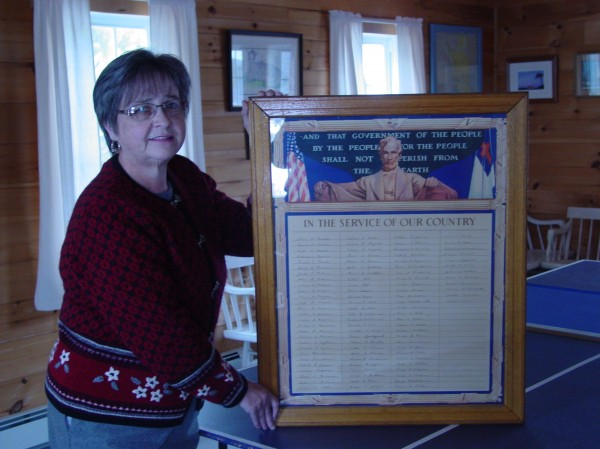 Pictured is Anne Mahonen Little with the Finnish-American World War II Veterans Honor Roll that has been displayed in the Finnish Congregational Church in South Thomaston for decades. Anne's father William Mahonen and uncles Armas and Toivo all served in the United States armed forces during that war.