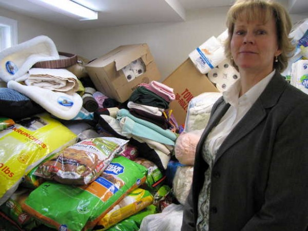 A laundry area and other spaces have turned into makeshift storage rooms for some of the food, bedding, bleach and even toys donated this weekend to the Franklin County Animal Shelter in Farmington, Heidi Jordan, executive director, said. It takes 20-plus pounds of dog/puppy food a day to care for the 75-dogs seized from a Wilton home on March 14.