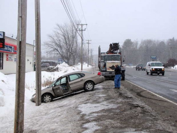 An empty pulp truck hit the rear of a sedan Monday morningand pushed it off Wilton Road in Farmington.