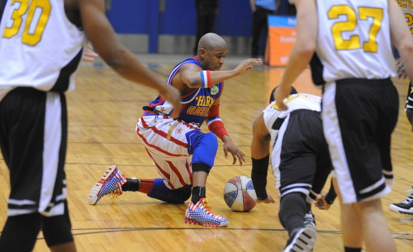 Harlem Globetrotter Scooter Christensen shows off his skills during the team's game against the Global Select at the Bangor Auditorium Tuesday evening.
