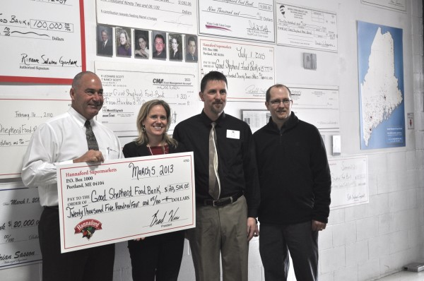 (L to R) Bob Hatem, director of operations for Hannaford district 3, Kristen Miale, president of the Food Bank, Randy Hoyt, Lewiston store manager, and Sam Michaud, VP of operations at the Food Bank.
