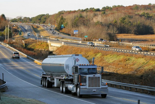 In this Nov. 18, 2011 photo, a heavy truck travels north on Route 1, alongside Interstate 295, in Yarmouth, Maine.